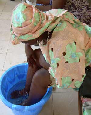 Woman washing feet